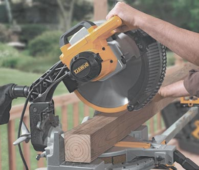 Man using mitre saw to cut the fram wood