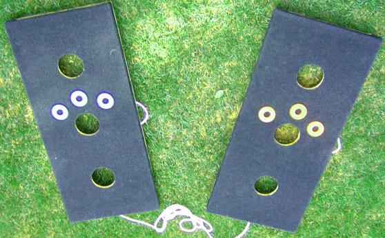 Washer toss three hole board