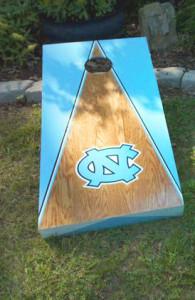 Wooden UNC cornhole board with blue triangle