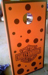 Orange wooden cornhole board