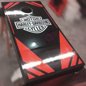 Red-black cornhole board decal with harley logo