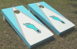 Carolina blue and white color combination of cornhole board along with Tar Heels foot icon in the middle